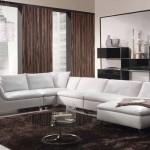 Sofá em L é uma boa opção para economizar espaço com elegância.